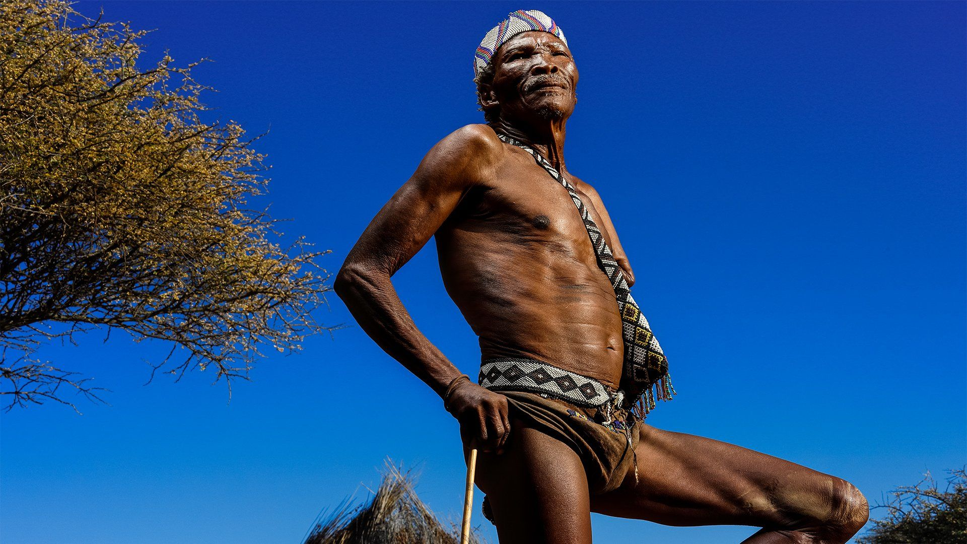 Brent Stirton capturing a namibian male standing behind dark blue sky shot on the Canon EOS R & RF 50mm f/1.2L USM